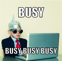 A strange child  sitting at computer in fancy dress with text saying busy busy busy