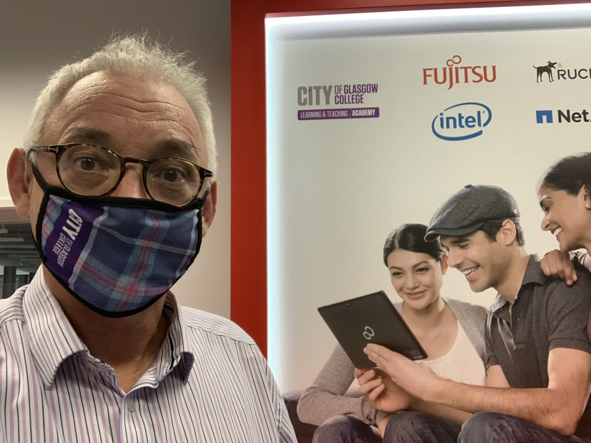 Image of Joe Wilson with Fujitsu Learning Hub in background